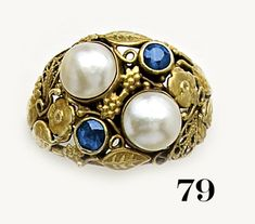 American Arts and crafts ring. Gold, sapphire and natural pearl. Similar to work by Edward Oakes. Heavy and clunky.