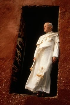 Pope John Paul II stands on the threshold of a former slave-trade depot on Goree Island during his 1992 trip to Senegal