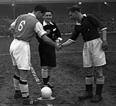 Arsenal 2 Bedford Town 2 in Jan 1956 at Highbury. The captains, Cliff Holton and Bob Craig, meet before this FA Cup 3rd Round tie.