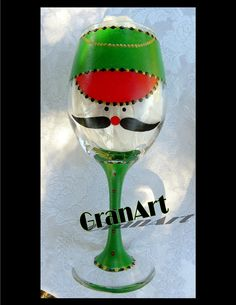 Nutcracker Wine Glass Christmas Green is hand painted with enamels and fired to preserve the paint.  Paint colors used; Christmas green, gold, red and