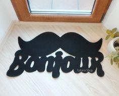 Door mat 'Bonjour' with mustache.  from Xatara