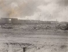 Freight cars 1/4 mile from explosion. These were to be loaded onto freight barge. April 18, 1947. Texas City Disaster Photographs, 1947. Special Collections, University of Houston Libraries (Public Domain).