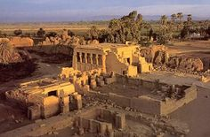 The approach path to the temple is between two Roman fountains that  end at the massive entry gate.The enclosure walls are mud-brick and date  to the Roman era. Within the walls are the temple, two birth houses, a  Coptic Basilica, a sanitorium, a sacred lake, and a  temple to Isis.