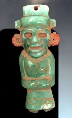 We see in this striking image the characteristic Teotihuacan art style, elegant and refined, stylized and ordered, resulting in an ancient work of art that also appears strikingly modern. The standing figure may be a god himself. In state of meditation, it appears as though he is chanting a prayer. This figure's smooth surface bears the ages of time and years of rubbing. The color green, bearing the breath of life, may have been carved specifically to represent good fortune and protection.