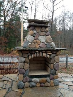 Gorgeous DIY outdoor fireplace covered in natural rock built by an amateur mason using a Backyard Flare, LLC construction plan. Outdoor Fireplace Plans, Outside Fireplace, Outdoor Fireplace Designs, Backyard Fireplace, Diy Fireplace, River Rock Fireplaces, Outdoor Stone Fireplaces, Stone Fire Pit Kit, Fireplace Gallery