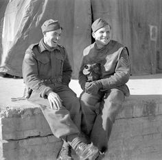 Private Kenneth E. White and Sergeant Norman C. Quick of the Canadian Army Film and Photo Unit, Ortona, Italy, 6 February 1944. February 6, 1944. Library and Archives Canada MIKAN 3206656