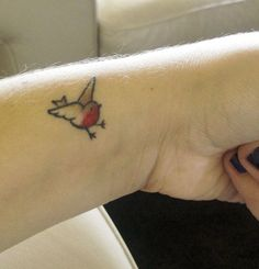 First tattoo, done by Tebi el Camaron at Green Lotus tattoos, Melbourne, Australia    This robin is based on Beatrix Potter's illustrations from Peter Rabbit.I got this on the anniversary of my discharge from hospital for a brain infection that almost killed me, and the wingspan is covering one of my worst scars.  I learnt how to talk again, I learnt how to talk again, and now I'm free.