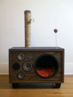 Cat bed made from an old speaker. My cats would love this. Wish I had kept my old speaker set.