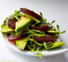 An avocado, beet and pea shoot salad. I would buy fresh beets and roast them, and then coat everything lightly with olive oil and balsamic vinegar. Easy Salad Recipes, Avocado Recipes, Easy Salads, Real Food Recipes, Vegan Recipes, Easy Meals, Vegan Food, Sprout Recipes, Beet Salad