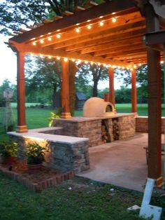 patio and pergola. trade out the pizza oven with space for the grill and smoker?