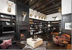 Stylish and manly study... sorry to anyone who is offended by the trophy's in the Texas Hillcountry home.