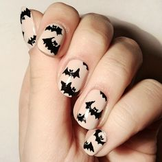 Bat nail art for halloween // love this manicure!