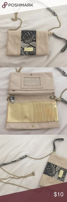 Steve Madden Wallet on Chain Pale pink with silver snakeskin print and gold chain. Interior wallet and zipper pocket. Very sleek for a night out. Gently used Steve Madden Bags Crossbody Bags