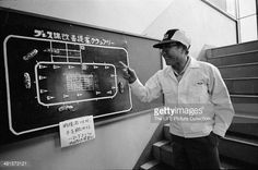Japanese industrialist and founder of Honda corporation, Soichiro Honda (1906 - 1991) points to a racing board, Tokyo, Japan, 1967.