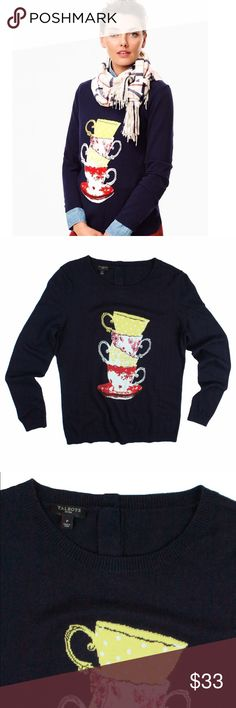 "TALBOTS Navy Blue Teacup Intarsia Sweater Absolutely excellent condition. Size is marked a size ""P"" this navy blue teacup intarsia sweater from Talbots features a yellow, white and red teacup intarsia knit design in front. It also has button closures behind the neckline. Made of a cotton blend. Measures: Bust: 34"", total length: 23"", sleeves: 23"" Talbots Sweaters Crew & Scoop Necks"