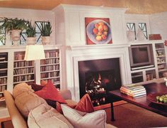 Lve the built in cabinets with the window... Place flat screen TV above fireplace