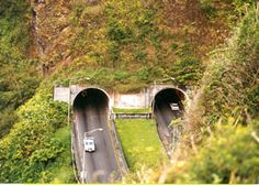 from the Nuuanu Pali overlook, the east portal of the Pali Tunnels on route 61, the divided highway that replaced the Pali Trail circa 1960. (September 1999)
