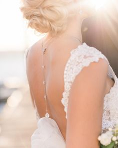 I'm in love with this low back @kennethwinston gown from @meamariebridal. Perfectly complemented by this @heidihulldesigns necklace. Seattle Wedding Photographer. Follow me on instagram! @bjonesphotos