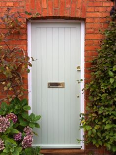 Pale green front door betwixt old red bricks and dark shrubbery. Front Door Paint Colors, Exterior Paint Colors, Exterior Design, Interior And Exterior, Paint Colours, Traditional Front Doors, Cottage Door, Bohemian House, Decks And Porches