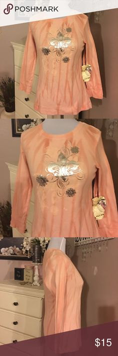 One world top One world top soft cotton fabric long sleeve new with tags. Size large. Peach color ONE WORLD Tops Tees - Long Sleeve