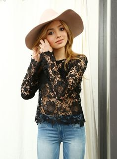 Black lace top and jeans, topped off with a floppy hat (Peyton List)