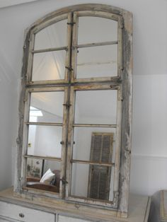 Large wooden arched top window mirror with traces of time worn paint