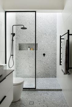 Renovated bathroom featuring grey tiles and black shower head with a skylight overhead. Bathroom Design Luxury, Bathroom Layout, Modern Bathroom Design, Best Bathroom Tiles, Minimalist Bathroom Design, Bathroom Grey, Bathroom Tile Designs, Bathroom Wall, Bad Inspiration