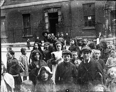 Tenement children in Henrietta Street 1913. Henrietta Street was one of Dublin city's earliest Georgian Streets. It dates from the 1720s and was the first project of Dublin's pre-eminent Georgian developer, Luke Gardiner. It was designed as an enclave of prestigious addresses. Built for one family. In 1913 some houses were to accommodate one hundred people in some of these houses. Out in the back yard was one toilet and a single water tap.
