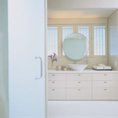 Would a large mirror like this with an art piece behind it solve our master bath mirror issue?