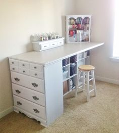 Short small repurposed dresser made into craft table- shelving under, wood board placed over dresser & shelving