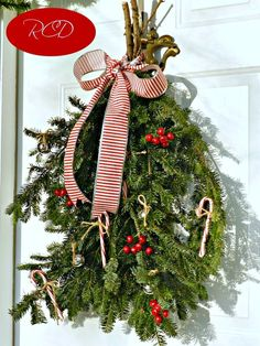 Christmas Swag Wreath made w/ left over Christmas tree limbs.  Then just tie on candy canes.