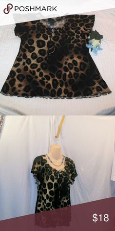 Susan Lawrence Dark Leopard Blouse Size Large Up for your consideration here is an adorable, kind of cutesy, dark leopard print blouse made by Susan Lawrence in a size large. This material is very soft, stretchy, and flowy. It ties up in the front creating a small peephole. It is a very eye-catching comfortable blouse. Make sure to shop my closet and pick out another item for yourself or someone else, bundle it together with this one to receive 10% off or more :-) Susan Lawrence Tops Blouses