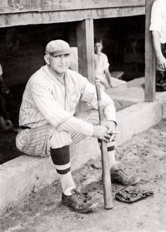 """Banned from professional baseball by Kennesaw Mountain Landis for alleged involvement in the """"Black Sox Scandal"""" of 1919, a 44 year old Shoeless Joe Jackson plays with the semi pro Greenville Spinners, circa 1932"""