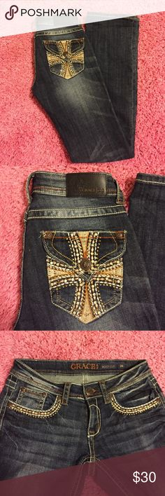 GRACE Jeans An awesome pair of Grace Jeans!!! I have only worn once or twice and they are beautiful! They have some bling on the front and back pockets. The bottom has a crease in the picture because I had them folded ready to hem, but then decided to sell. I am 5'2 and typically a short in Jeans, these are a little long (should be a regular) In near perfect condition! No trades please. Grace Jeans Boot Cut