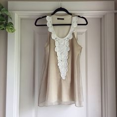 Floral Rope Tank Beautiful two-layer tank top with ivory rope like flower detail around the collar and front. Cream/ivory layer underneath and light brown sheer layer on top. Tops Tank Tops