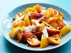 Nectarine-Tomato Salad : The flavors of yellow tomatoes and ripe nectarines are complemented by a simple olive oil and balsamic dressing. Toasted pine nuts and shaved cheese add the finishing touches.
