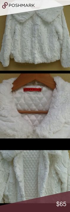 Alice + Olivia jacket So soft and cuddly...winter white jacket. Fully lined with white quilting. Two side front pockets and four hooks fasten up the front. Chest measures 38,length is 21 inches from the collar. Shoulder to shoulder back measures 16. In excellent condition. Alice + Olivia Jackets & Coats