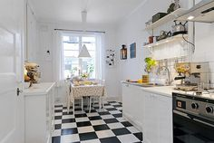 Black & White is really not my thing--but it's perfect for a kitchen or a bathroom. I love this kitchen from the tip of its open cabinets to its tiled-toes.