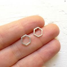 Tiny sterling silver hexagon stud earrings measure 8mm. Sterling silver ear clutches included.