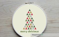 Christmas cross stitch pattern. Modern christmas tree triangles  The pattern comes as a PDF file that youll will be able to download immediately after purchase. In addition the PDF files are available in you Etsy account, under My Account and then Purchase after payment has been cleared. You get a pattern in colorblocks and symbols, a pattern in black and white symbols, and a list of the floss colors youll need. You also get an PDF file with cross stitch instructions.  PATTERN INFORMATION…