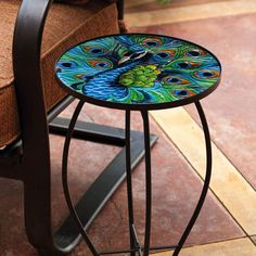 Add whimsical fun to your outdoor space with this stunning side table; Embossed and colorfully-painted dragonfly glass table with a metal frame Gender: unisex.