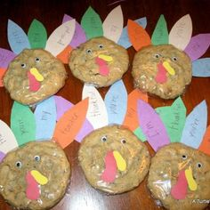 """Cookie wrapped in cellphane and paper embellishments added.  Feather say """"I am thankful for ........"""""""