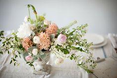 lovely flower arrangements - love the linen tablecloth and color scheme