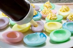 Died Deviled Eggs    Make the colors just as you would easter egg dye.    A teaspoonful of cider vinegar in each glass helps.    I used about 3 drops of food coloring in each glass.    Pull out when they are a pastel color.  Drain on paper towel, then fill.