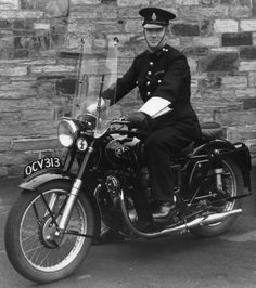 Cornwall Constabulary Constable Lester Vaskaby, riding an AJS motorcycle in a photograph taken at Police HQ, Bodmin, British Police Cars, Ajs Motorcycles, Police Uniforms, British History, Cornwall, Police Vehicles, Motorbikes, Law, Photograph