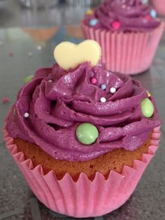 Pin strawberry flavoured cupcake with purple frosting