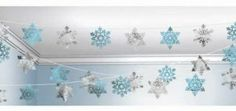 Complete the #Frozen theme with our Snowflake hanging garland http://www.partyrama.co.uk/shop/a-z-ceiling-decorations/christmas-snowflakes-ceiling-string-decoration-100-feet-long/