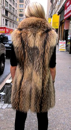 Pre-owned Asiatic Raccoon vest.... a sample of what we can do with the heavy wild fur coats that you will not wear.