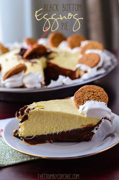Black Bottom Eggnog Pie | A rich, dark chocolate ganache pudding base, topped with a light and fluffy eggnog mousse, and layered in a spicy gingersnap crust. Say goodbye to the holidays with style!