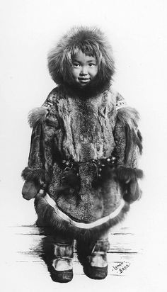Small Inuit boy in fur clothing    Image No: ND-1-18    Title: Inuit boy in winter clothing, Nome (?), Alaska.    Date: [ca. 1903-1908]